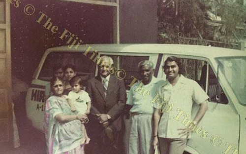 Dhansukh's family beside their old Hiralal Laundry van. Dhansukh Chauhan is pictured far right. In the 1960s, the laundry business in Fiji was undermined by household washing machines.